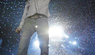 Kid Rock performs at Ford Field in Detroit, Saturday, Jan. 15, 2011. (AP Photo/Carlos Osorio)