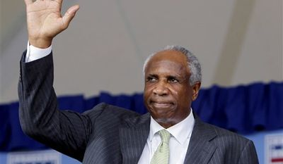 FILE - This June 19, 1996 file photo shows Frank Robinson at a news conference in Cleveland, Oh., after being named the major leagues first black manager, with the Cleveland Indians. In the background is baseball commissioner Bowie Kuhn. Robinson has taken by ambulance to a hospital, Thursday, Jan. 13, 2011, with what has been described as dizziness and a rapid heartbeat. Robinson was at a Phoenix-area resort in a meeting of baseball owners and general managers when he fell ill. (AP Photo/File)
