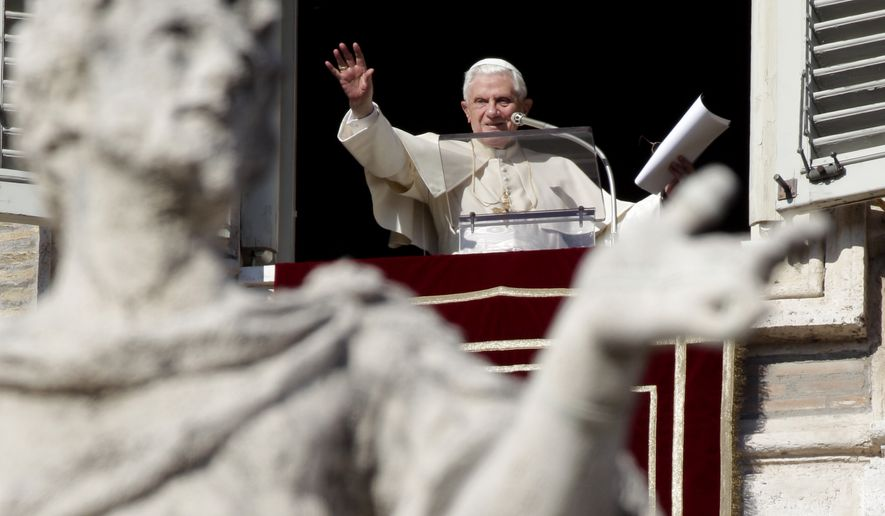 "Pope Benedict XVI waves to the faithful at the end of the Angelus prayer from his studio window overlooking St. Peter's Square at the Vatican on Sunday, Jan. 16, 2011. Benedict told pilgrims that he was praying for people in Australia, Brazil, the Philippines and Sri Lanka who are suffering because of ""devastating"" flooding. (AP Photo/Pier Paolo Cito)"