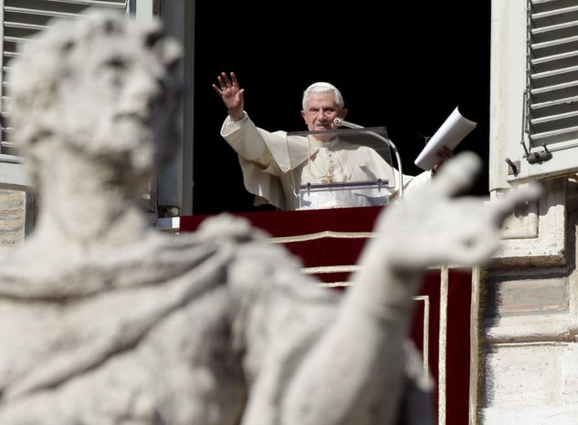 """Pope Benedict XVI waves to the faithful at the end of the Angelus prayer from his studio window overlooking St. Peter's Square at the Vatican on Sunday, Jan. 16, 2011. Benedict told pilgrims that he was praying for people in Australia, Brazil, the Philippines and Sri Lanka who are suffering because of """"devastating"""" flooding. (AP Photo/Pier Paolo Cito)"""