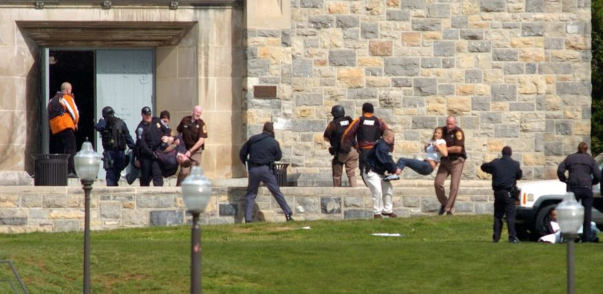 ** FILE ** Victims of the April 2007 massacre at Virginia Tech are carried out of Norris Hall. The mass shooting caused many colleges to reassess security measures, but dealing with troubled students remains a difficult issue. (AP Photo)
