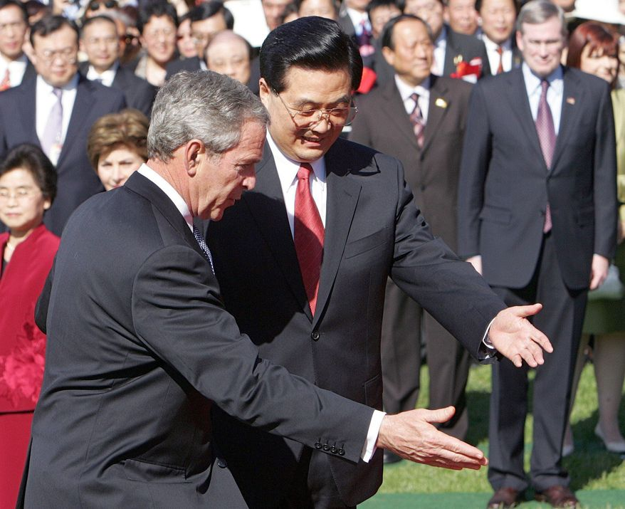 President George W. Bush welcomes Chinese President Hu Jintao in a South Lawn arrival ceremony in April 2006. Mr. Hu was disappointed to have lunch with the president instead of a state dinner. (Associated Press)
