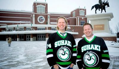 "Suhaki, the name Steve Ekman (left) and Hans Halvorson proudly wear on their jerseys, is a bit of wordplay pronounced like ""Sioux hockey."" They are among University of North Dakota alumni and fans trying to save the UND nickname Fighting Sioux. (Associated Press)"