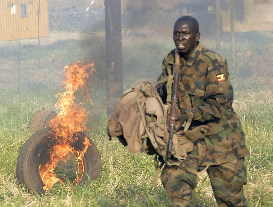 **FILE** One of the 1,800 Uganda Peoples Defence Force (UPDF) soldiers being sent to the African Union peacekeeping mission in Somalia participates in a Dec. 21 drill at Singo Military training camp, about 100 kilometers north of Kampala. (Associated Press)