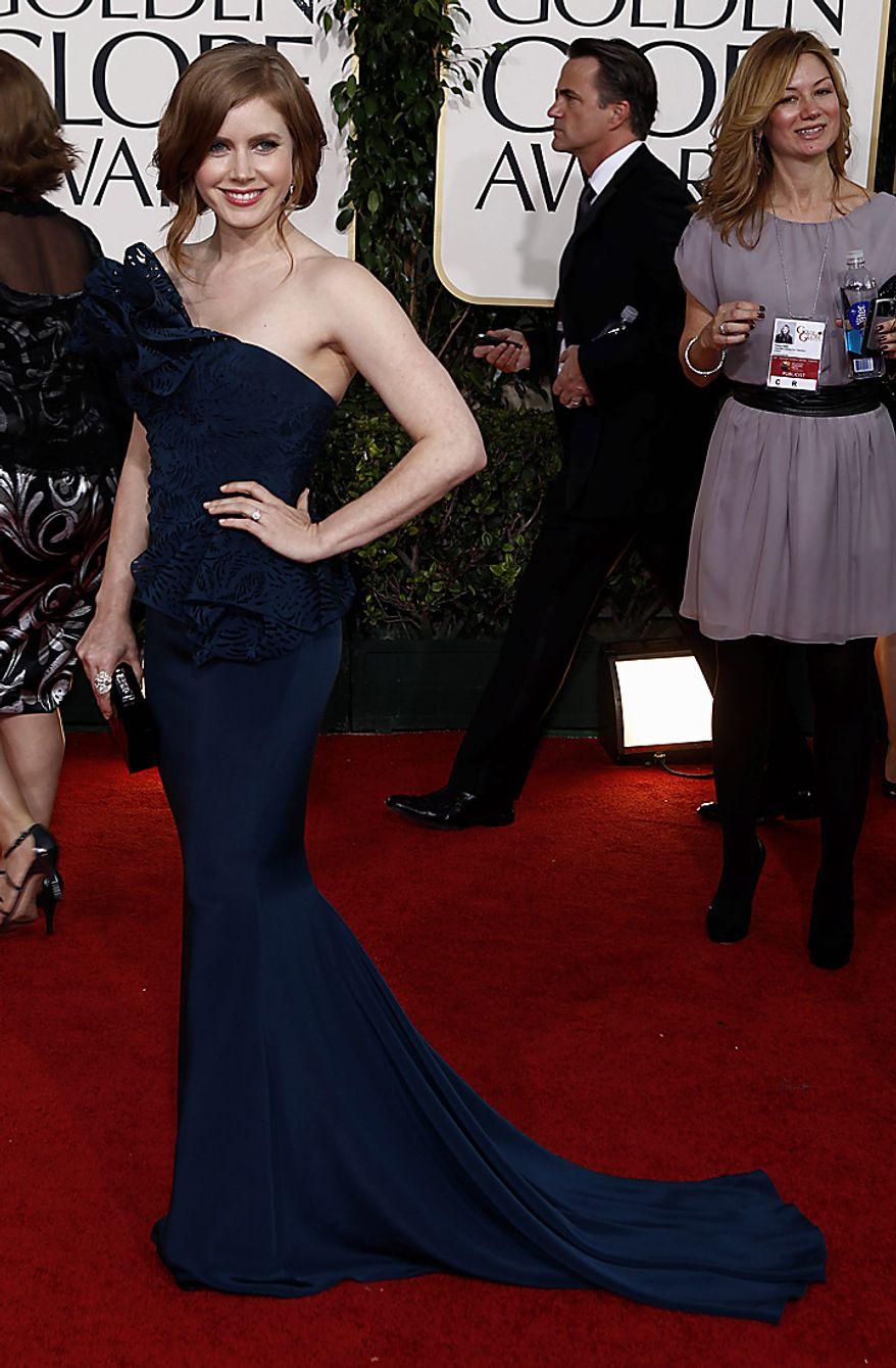 Amy Adams arrives for the Golden Globe Awards Sunday, Jan. 16, 2011, in Beverly Hills, Calif. (AP Photo/Matt Sayles)