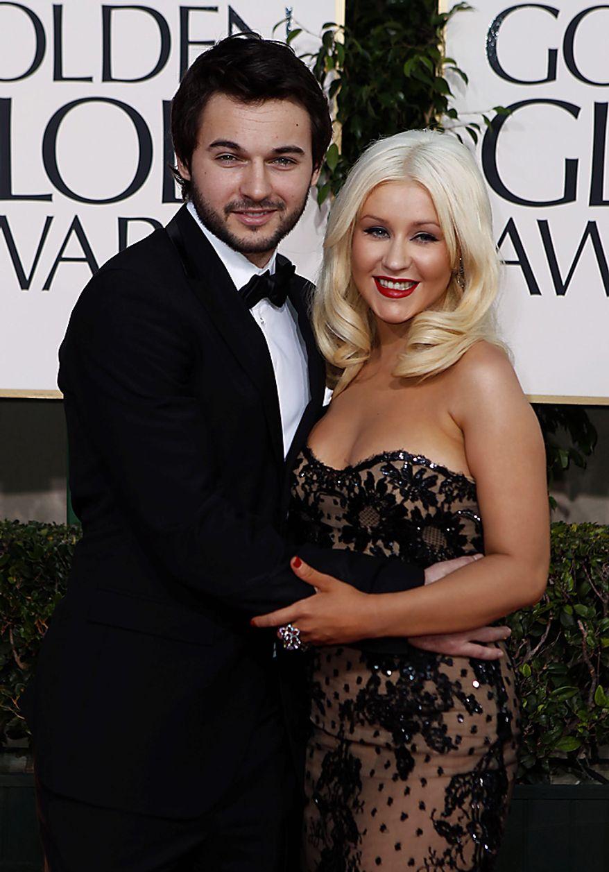 Christina Aguilera arrives with her husband Jordan Bratman for the Golden Globe Awards Sunday, Jan. 16, 2011, in Beverly Hills, Calif. (AP Photo/Matt Sayles)