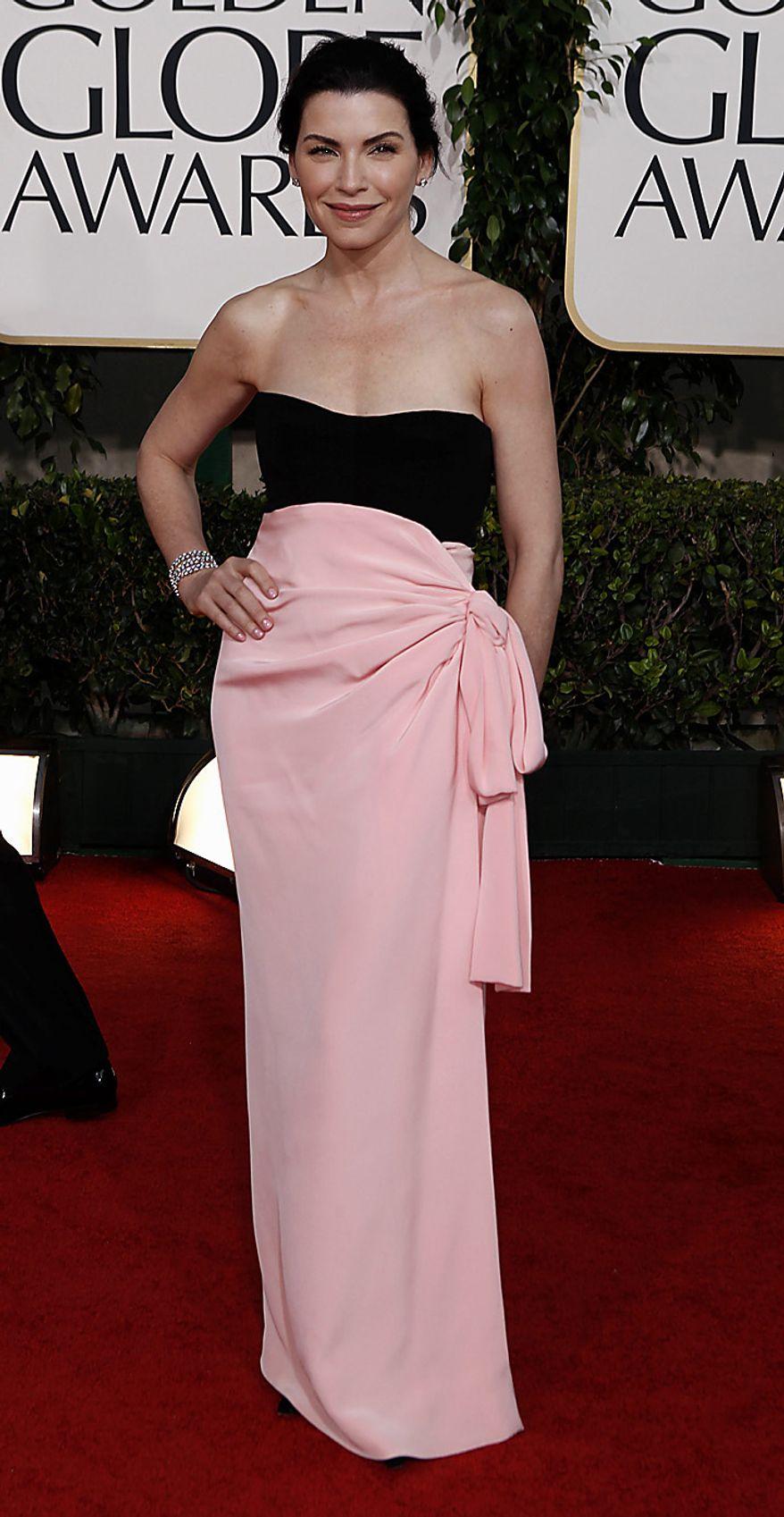 Julianna Margulies arrives for the Golden Globe Awards Sunday, Jan. 16, 2011, in Beverly Hills, Calif. (AP Photo/Matt Sayles)