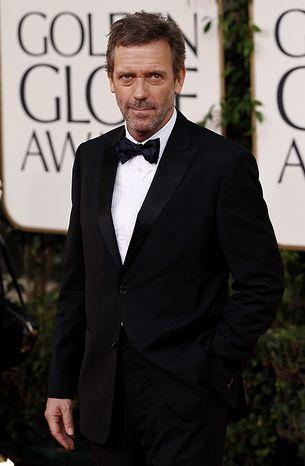 Hugh Laurie arrives for the Golden Globe Awards Sunday, Jan. 16, 2011, in Beverly Hills, Calif. (AP Photo/Matt Sayles)