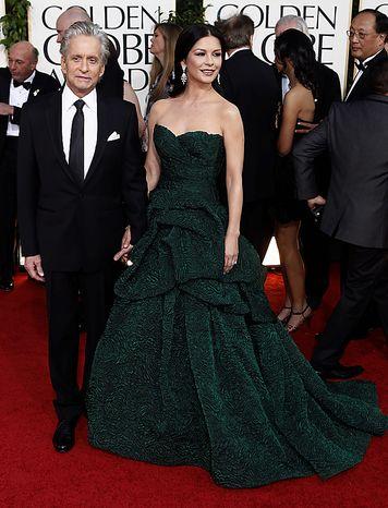 Michael Douglas arrives with his wife Catherine Zeta-Jones for the Golden Globe Awards Sunday, Jan. 16, 2011, in Beverly Hills, Calif. (AP Photo/Matt Sayles)
