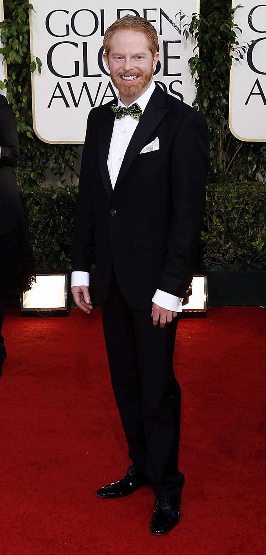 "Jesse Tyler Ferguson of ""Modern Family,"" arrives for the Golden Globe Awards Sunday, Jan. 16, 2011, in Beverly Hills, Calif. (AP Photo/Matt Sayles)"