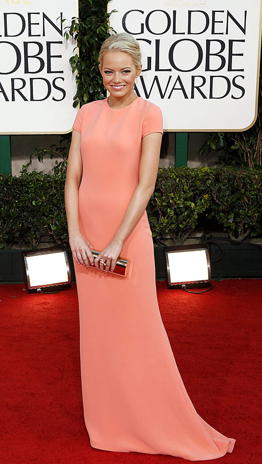 Actress Emma Stone arrives at the Golden Globe Awards Sunday, Jan. 16, 2011, in Beverly Hills, Calif. (AP Photo/Matt Sayles)