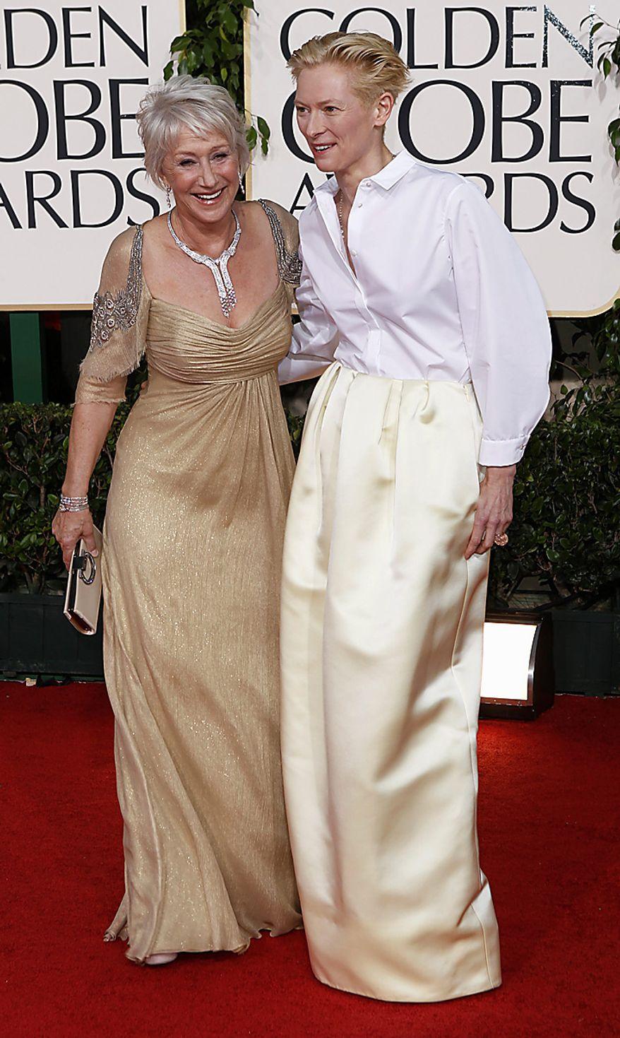 Tilda Swinton, right, and Helen Mirren arrive for the Golden Globe Awards Sunday, Jan. 16, 2011, in Beverly Hills, Calif. (AP Photo/Matt Sayles)