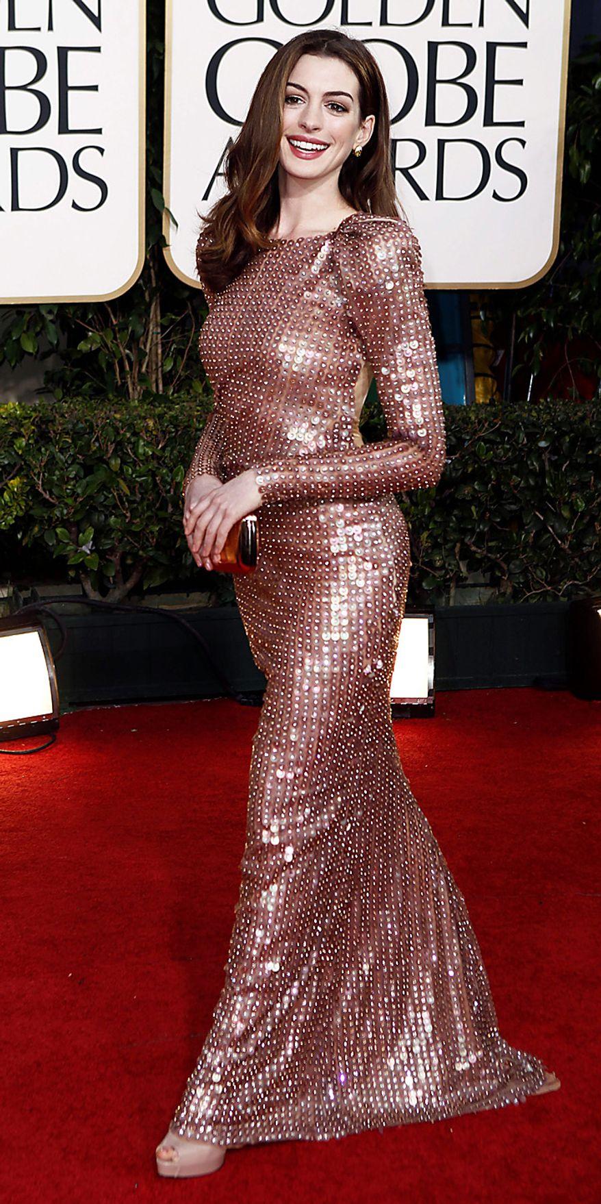 Anne Hathaway arrives for the Golden Globe Awards Sunday, Jan. 16, 2011, in Beverly Hills, Calif. (AP Photo/Matt Sayles)