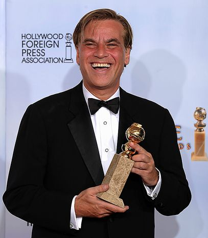 """Aaron Sorkin holds the award he was given for Best Screenplay - Motion Picture for """"The Social Network,"""" at the Golden Globe Awards Sunday, Jan. 16, 2011, in Beverly Hills, Calif. (AP Photo/Matt J. Terrill)"""