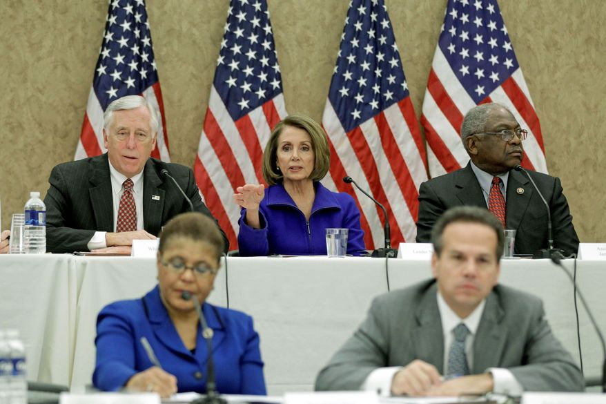 House Minority Leader Nancy Pelosi of California (center), flanked by House Minority Whip Steny H. Hoyer of Maryland (left) and House Assistant Minority Leader James E. Clyburn of South Carolina, takes part in a Democratic Leadership Meeting on repealing the health care law Tuesday on Capitol Hill. Seated in the foreground are Rep. Karen Bass of California and Rep. David Cicilline of Rhode Island. (Associated Press)