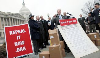 "Rep. Steve King, Iowa Republican, speaks at a news conference Tuesday on Capitol Hill after accepting delivery of signed petitions demanding the repeal of ""Obamacare."" (Associated Press)"