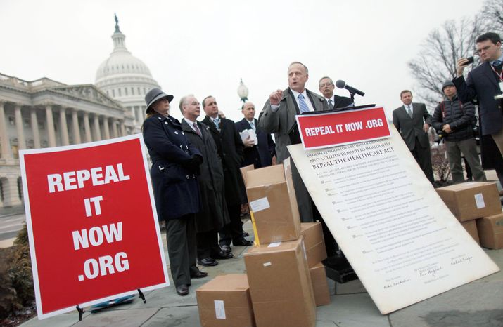 """Rep. Steve King, Iowa Republican, speaks at a news conference Tuesday on Capitol Hill after accepting delivery of signed petitions demanding the repeal of """"Obamacare."""" (Associated Press)"""