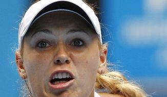 Caroline Wozniacki eyes the ball for a return to Vania King during their second-round match Wednesday at the Australian Open tennis championships in Melbourne, Australia. (Associated Press)