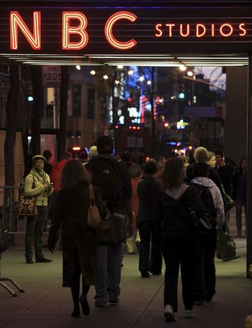 The NBC logo glows in neon lights at its headquarters in New York. The Federal Communications Commission approved Comcast Corp.'s proposed purchase of NBC Universal on Tuesday, Jan. 18, 2011. (AP Photo/Bebeto Matthews, file)