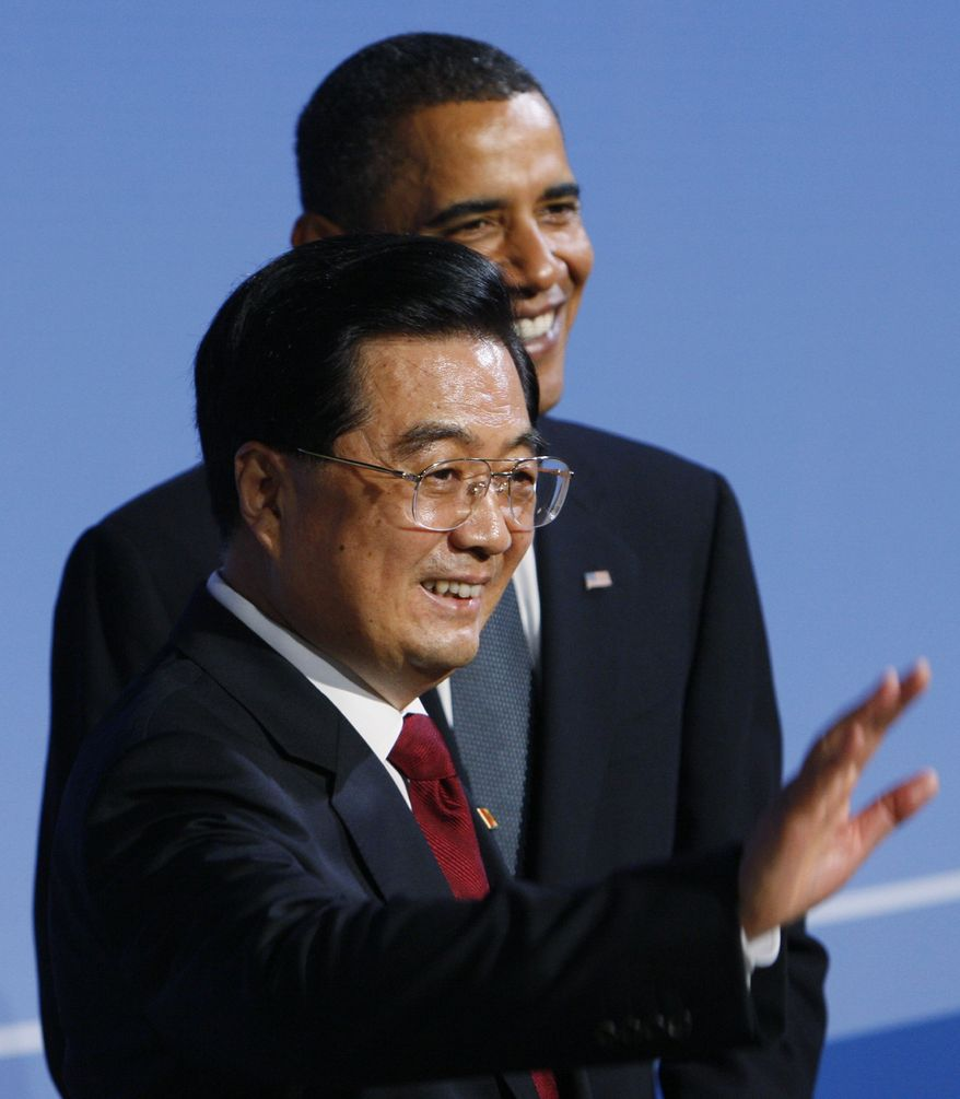 ** FILE ** In this Sept. 24, 2009, file photo, President Barack Obama welcomes China's President Hu Jintao as he arrives for the G-20 summit dinner in Pittsburgh. (AP Photo/Charles Dharapak, File)