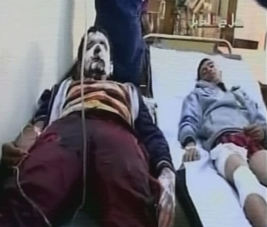 Injured Iraqis receive treatment at a hospital in Tikrit, Iraq, after a suicide bomb attack that left more than 50 dead in this image taken from TV Tuesday,  Jan. 18. 2011. (AP Photo/Salah Al-Din via APTN)