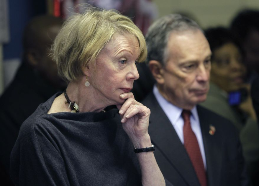 ** FILE ** New York City Schools Chancellor Cathie Black, left, and Mayor Michael Bloomberg look over a classroom in P.S. 262 on her first day as chancellor in New York, on Monday, Jan. 3, 2011. (AP Photo/Seth Wenig)