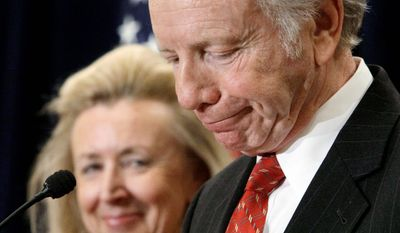 U.S. Sen. Joe Lieberman, Connecticut independent, accompanied by his wife, Hadassah, addresses a gathering Wednesday in Stamford, Conn. He has announced that he will not seek a fifth term in 2012. (Associated Press)