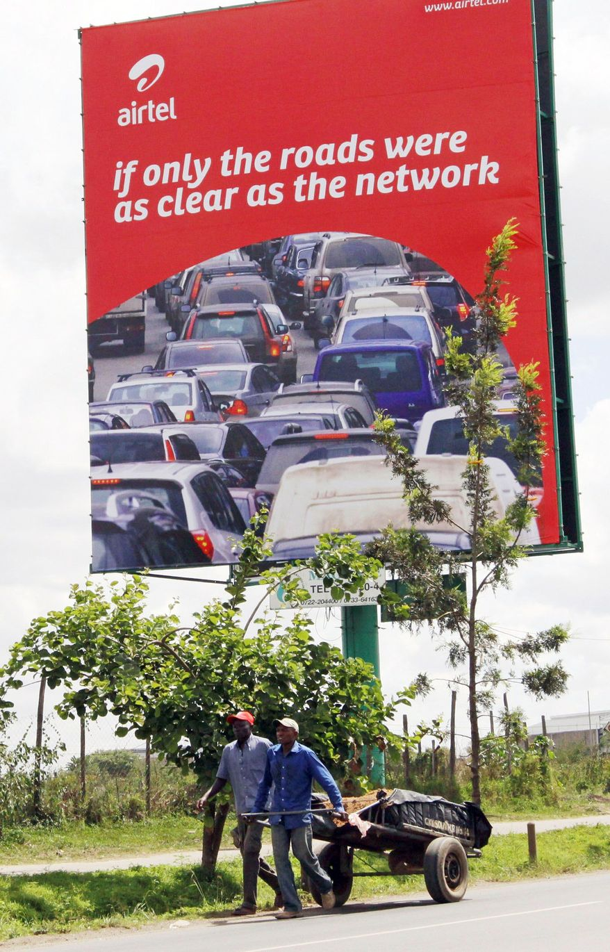 An Airtel billboard in Nairobi, Kenya, reflects the aggressiveness of the communications giant. Millions of mobile-phone subscribers in Africa saw the company icon on their phone screens change from Zain to Airtel last fall. (Associated Press)