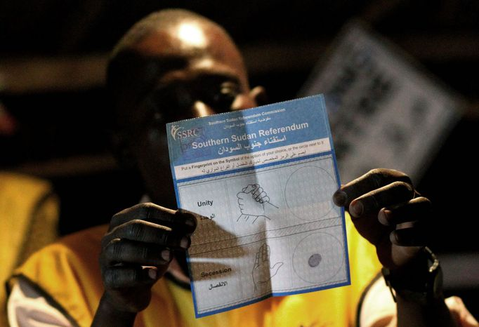 An election official in Juba, southern Sudan, holds up a pro-independence ballot as votes are counted at a polling station in the southern capital, Juba. Weeklong balloting ended Saturday; most observers expect the south to secede from the north. (Associated Press)