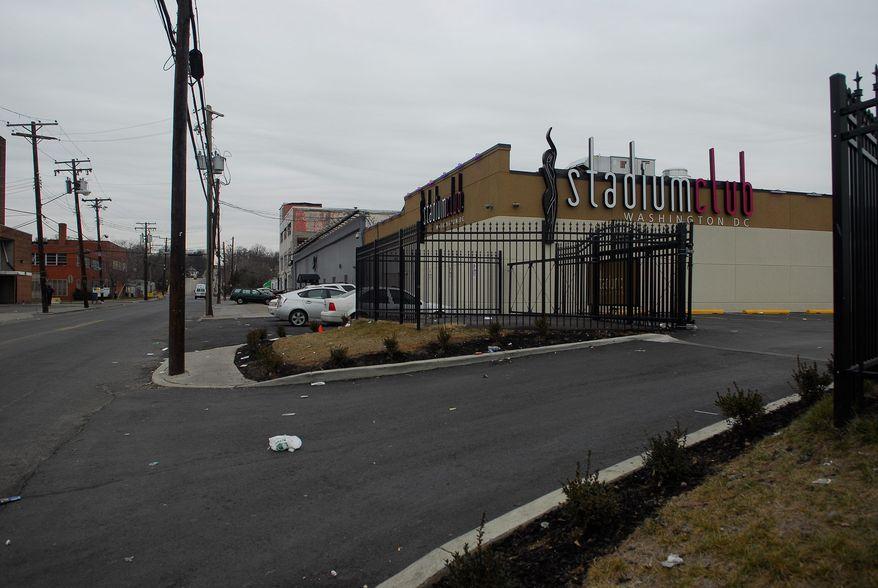 **FILE** The Stadium Club, a strip club n Northeast Washington (J.M. Eddins Jr./The Washington Times)