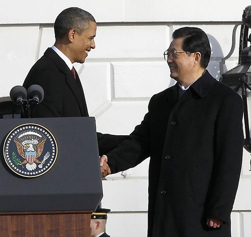 President Barack Obama shakes hands with China's President Hu Jintao during a state arrival ceremony, Wednesday, Jan. 19, 2011, on the South Lawn of the White House in Washington. (AP Photo/Charles Dharapak)