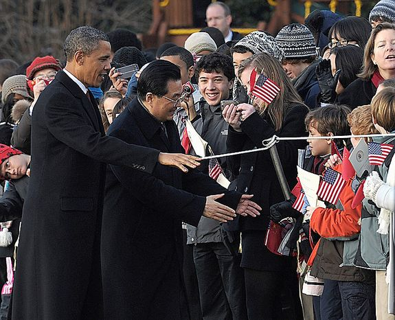 President Barack Obama and China's President Hu Jintao greet guests during a state arrival ceremony at the White House in Washington,  Wednesday, Jan. 19, 2011.  (AP Photo/Susan Walsh)