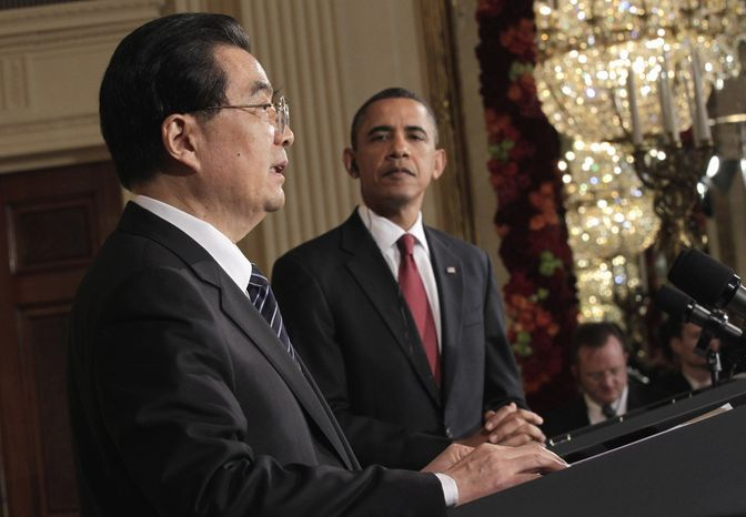 President Obama looks on as Chinese President Hu Jintao speaks during their joint news conference on Wednesday, Jan. 19, 2011, in the East Room of the White House in Washington. (AP Photo/J. Scott Applewhite)