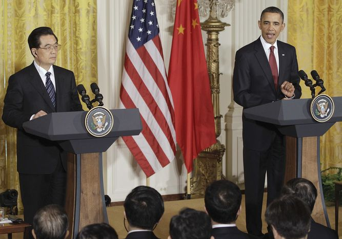 President Obama makes opening remarks during joint press conference with China's President Hu Jintao, Wednesday, Jan. 19, 2011, in the East Room of the White House in Washington. (AP Photo/Charles Dharapak)