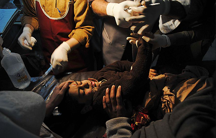 A student injured in a bomb explosion receives treatment at Lady Reading hospital in Peshawar, Pakistan, Wednesday, Jan. 19, 2011. The bomb exploded outside a school in a residential area of Peshawar city on Wednesday, killing at least one person and wounding 14 others. (AP Photo/Mohammad Iqbal)