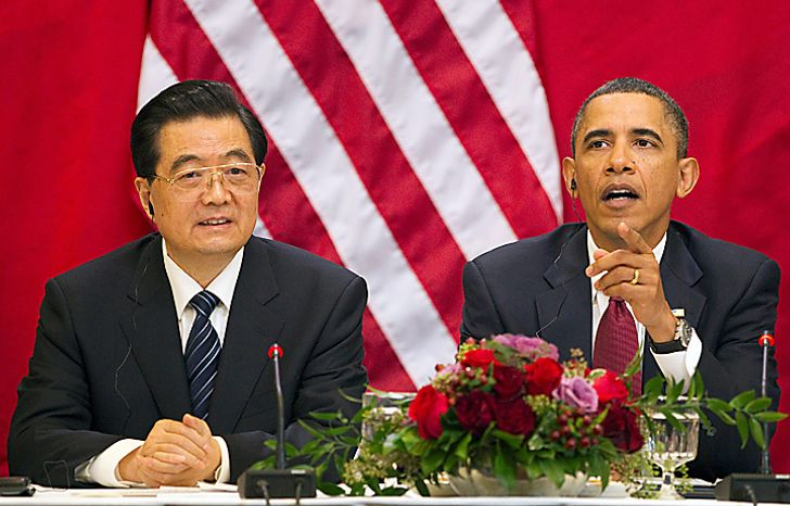 President Barack Obama, accompanied by China's President Hu Jintao, gestures during their meeting with business leaders, Wednesday, Jan. 19, 2011, in the Eisenhower Executive Office Building on the White House complex in Washington. (AP Photo/Evan Vucci)