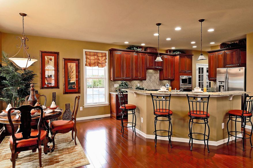 The Putnam model at the Villages at Loudoun Valley in Ashburn has an open center-island kitchen, breakfast area and family room at the back of the home. The Putnam has 3,196 square feet and is priced from $509,995.