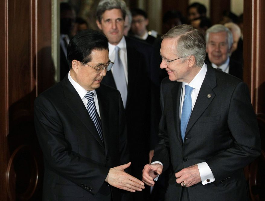 """Chinese President Hu Jintao meets with Senate Majority Leader Harry Reid, Nevada Democrat, on Capitol Hill on Thursday. Earlier this week, Mr. Reid had referred to Mr. Hu as a """"dictator."""" (Associated Press)"""