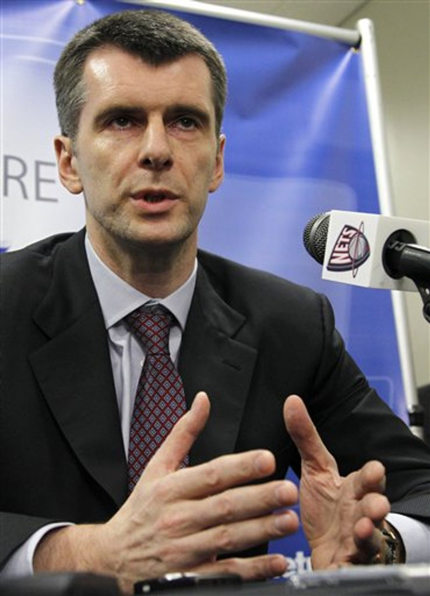 Mikhail Prokhorov, owner of the New Jersey Nets, talks to reporters before an NBA basketball game between the Nets and the Utah Jazz, Wednesday, Jan. 19, 2011, in Newark, N.J. Prokhorov said he has told the team to end discussions on the Carmelo Anthony deal. (AP Photo/Julio Cortez)