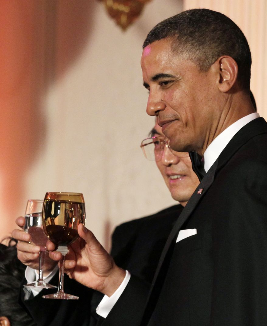 President Obama and Chinese President Hu Jintao toast during a state dinner Wednesday night at the White House. The Chinese leader will travel later this week to Mr. Obama's hometown of Chicago. (Associated Press)