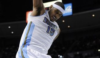 Oklahoma City Thunder guard Russell Westbrook (0) is fouled by Denver Nuggets forward Kenyon Martin (4) as Timofey Mozgov (25) from Russia looks on during the first quarter of an NBA basketball game Tuesday, April 5, 2011, in Denver. (AP Photo/Jack Dempsey)