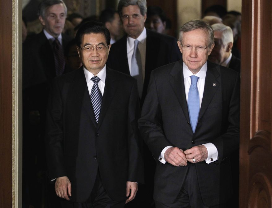 China's President Hu Jintao walks with Senate Majority Leader Harry Reid of Nev. on Capitol Hill in Washington, Thursday, Jan. 20, 2011. Senate Foreign Relations Committee Chairman Sen. John Kerry, Massachusetts Democrat, is at center. (AP Photo/Carolyn Kaster)
