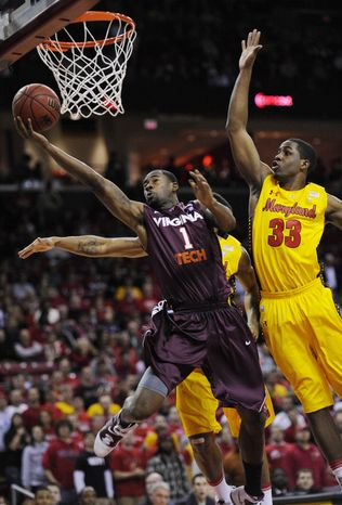 Virginia Tech's Terrell Bell (1) goes to the basket against Maryland forward Dino Gregory (33) during the first half of an NCAA college basketball game, Thursday, Jan. 20, 2011, in College Park, Md. (AP Photo/Nick Wass)