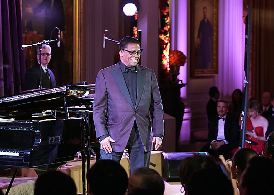 Musician Herbie Hancock arrives in the State Dining Room of the White House in Washington, Wednesday, Jan. 19, 2011, to perform for President Barack Obama, first lady Michelle Obama, China's President Hu Jintao, and guests during a State Visit.  (AP Photo/Carolyn Kaster)