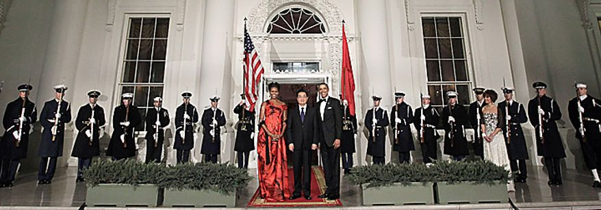 President Barack Obama and first lady Michelle Obama greet China's President Hu Jintao upon his arrival at the North Portico of the White House in Washington, Wednesday, Jan. 19, 2011. (AP Photo/Pablo Martinez Monsivais)