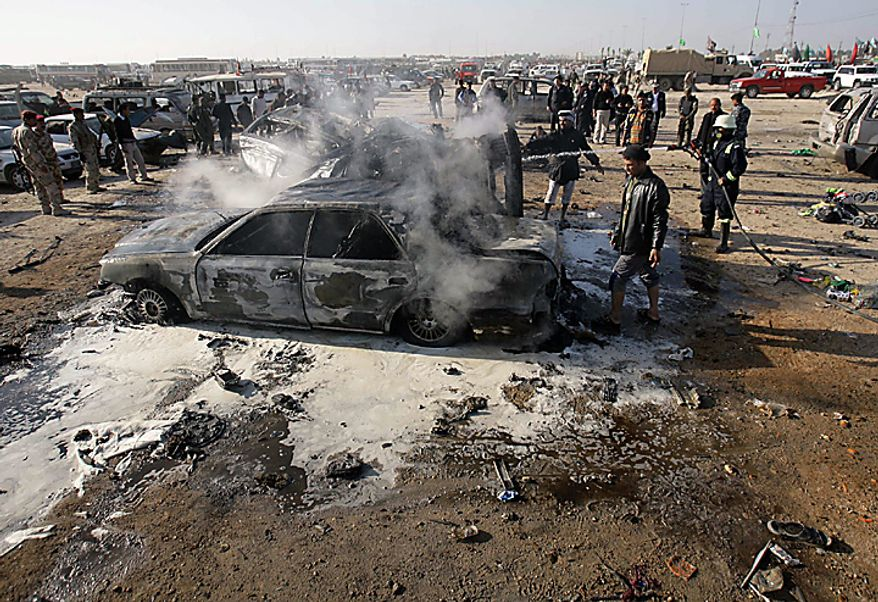 A destroyed car after a bombing in Karbala, 50 miles south of Baghdad, Iraq, Thursday, Jan. 20, 2011. A pair of bombs blasted through security checkpoints ringing the Iraqi holy city of Karbala Thursday and killed scores, most of whom were Shi'ite pilgrims headed to observe yearly religious rituals. (AP Photo/Ahmed al-Husseini)
