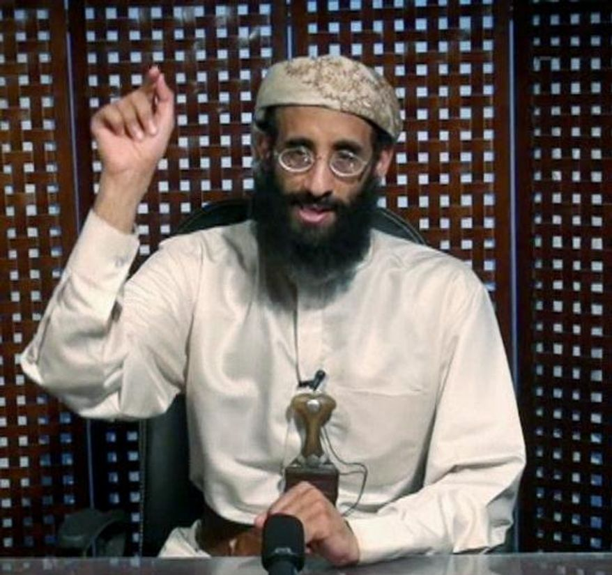 In this image taken from video, Anwar al-Awlaki speaks in a video message posted on radical websites Nov. 8. (SITE Intelligence Group via Associated Press)