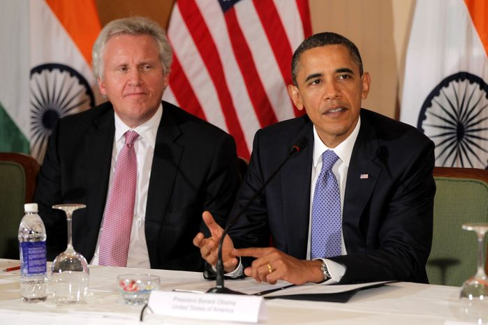 ** FILE ** General Electric's Jeffrey Immelt looks on as President Obama speaks at a round-table discussion with business leaders in Mumbai, India, on Nov. 6, 2010. Mr. Obama is restructuring his economic advisory board and naming Mr. Immelt as it new head. (AP Photo/Charles Dharapak)