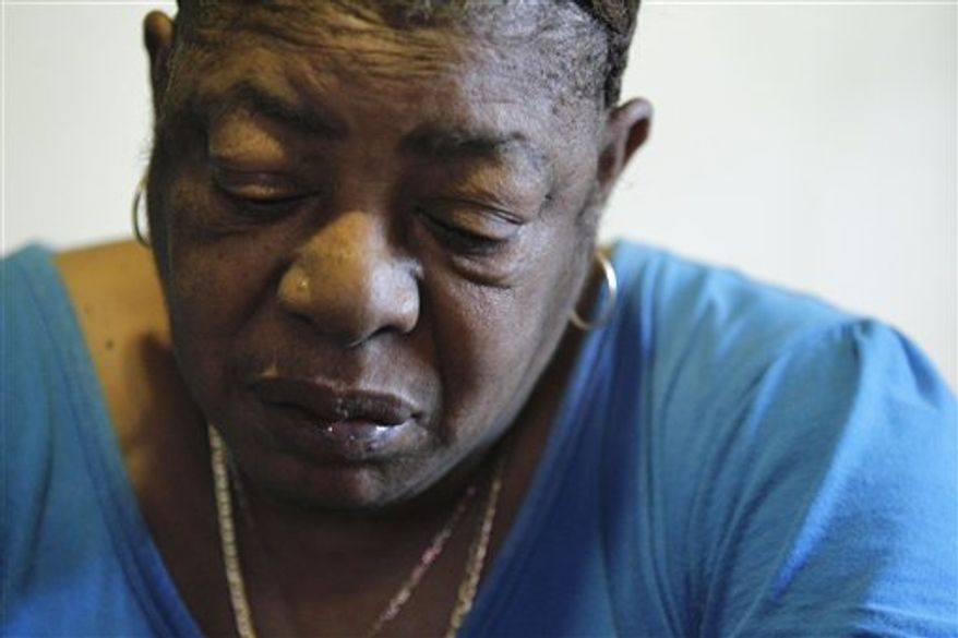 Johnnie Mae Smith, 61, mother of Marie Smith who sued Dr. Kermit Gosnell after a botched abortion, looks at a newspaper with Gosnell's photo on it during an interview with the Associated Press in Philadelphia Thursday, Jan. 20, 2011. Abortion doctor Kermit Gosnell, who catered to minorities, immigrants and poor women at the Women's Medical Society, was charged Wednesday Jan. 19, 2011, with eight counts of murder in the deaths of a patient and seven babies who were born alive and then killed with scissors, prosecutors said Wednesday. (AP Photo/Matt Rourke)