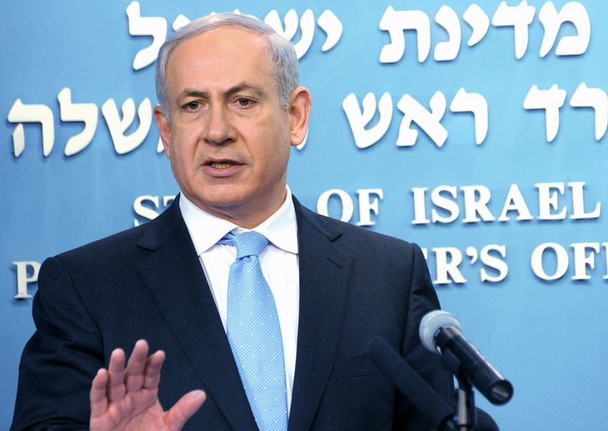 Israeli Prime Minister Benjamin Netanyahu delivers a statement Sunday about an Israeli government probe of the 2010 Gaza Strip flotilla raid. The military and government were cleared of wrongdoing. Nine passengers were killed in the clash with commandos. (Associated Press)
